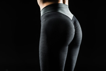 Beautiful female body part. Female buttocks isolated on black background. Beautiful female slim body.