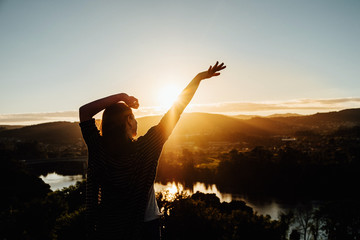 Silhouette of a woman in sunlight, happiness or freedom concept