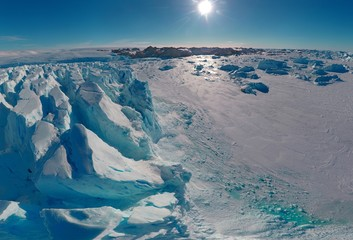 Panorama on icebergs and ice on the water in front of him, terrain and scenery Antarctic , day, sunset.