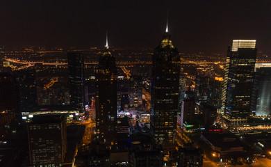 Night panoramic aerial view of skyscrapers