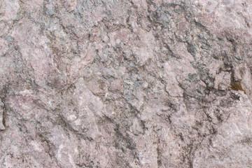 Seamless gray rock texture background closeup