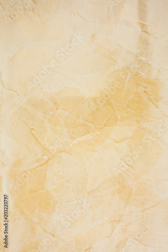 Wall of decorative yellow plaster background\