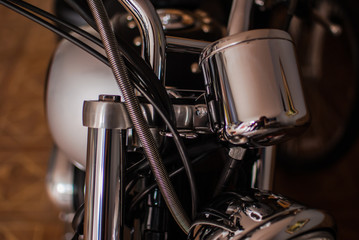 Closeup of chopper's chrome handlebar, fork, and actuator