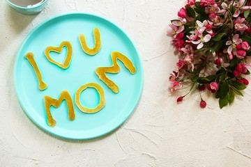 Mothers day brunch  Pancakes in shape of I Love You Mom, top view