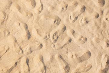 Many footprints on sand.