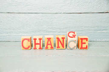 The Word change writen on a wooden cube turned into Chance