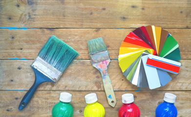 Paintbrushes, paint, color swatch, refurbishing, decorating, painting concept, flat lay