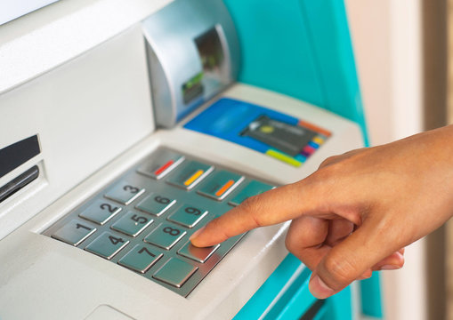 Enter ATM code,Withdrawing money from an ATM,Enter the code on the ATM keyboard,pass code on ATM,press bank matchine keypad