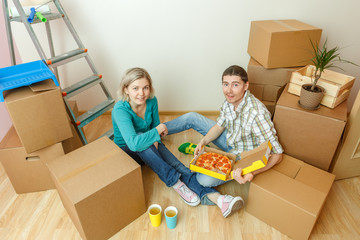 Photos of women and men eating pizza among cardboard boxes