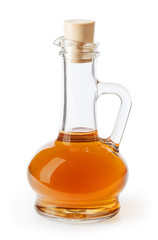 Apple cider vinegar in glass bottle isolated on white background with clipping path