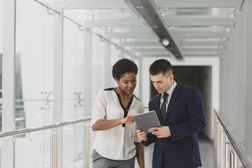 Business people having meeting in modern office using digital tablet