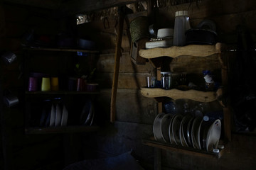 Shelves filled with kitchenware hang in a house in the mountains near Santo Domingo, Cuba