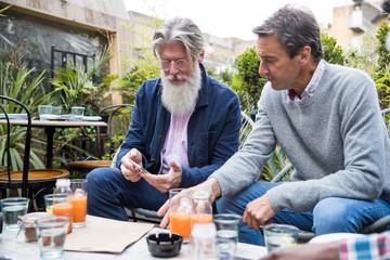 Senior men sitting in restaurant