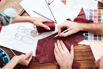 Top view two fashion designers making cutout. Wall mural