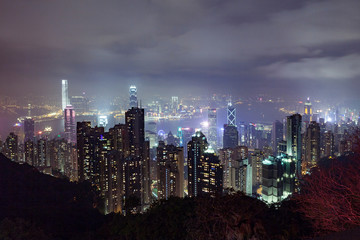 Cityscape of skyscrapers illuminated at night, Hong Kong, China, East Asia