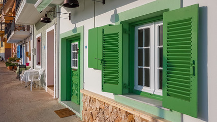 windows in alley in parga city greece