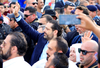 A man uses his cell phone to take a picture of Lebanese Prime Minister and a candidate for parliamentary elections Saad al-Hariri, as he gestures during a campaign rally in Sidon