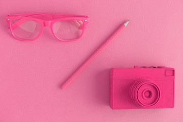 Pink objects on pink background minimal creative photography concept.