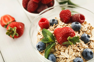 Healthy breakfast on white wooden table, closeup