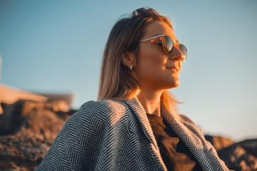 Portrait of woman wearing sunglasses looking away smiling