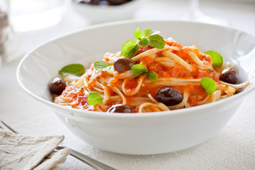 Bowl Of Pasta With Homemade Tomato Sauce And Olives