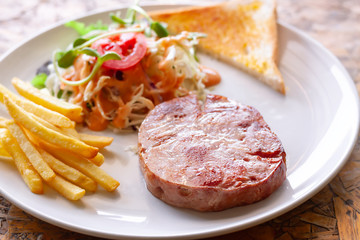 Ham steak and vegetable salad
