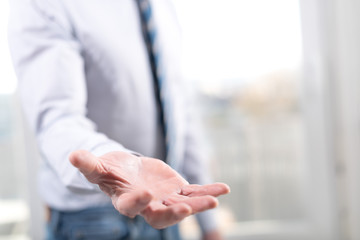 Hand of man in gesture of support