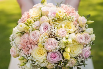 A beautiful wedding bouquet made of roses is a detectable shot that can be used as a background