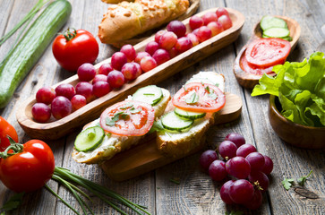 Healthy sandwiches with vegetables on wood.