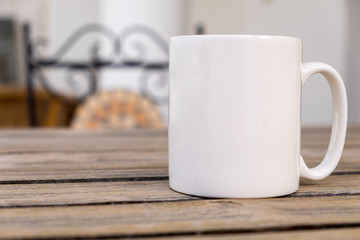 White blank coffee mug mock set-up, outside on a little wooden table with an ironwork chair in the background.	Perfect for businesses selling mugs, just overlay your quote or design on to the image.