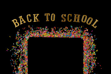 Border frame of colorful sprinkles on a black background with copy space. Top view or flat lay. Concept design for back to school, poster and card