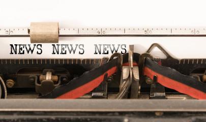 NEWS NEWS NEWS written on vintage manual typewriter