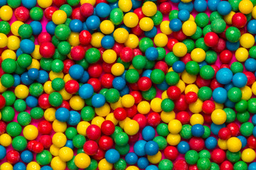 Sweet colourful candy balls background.