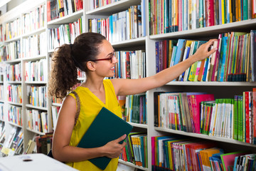young woman in book shop.