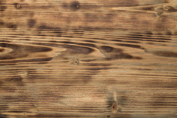 Burned wooden textured background.