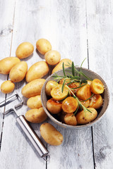 Roasted potato with fresh rosemary in a bowl