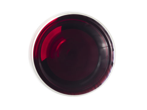 Glas of red wine pictured from above on white surface