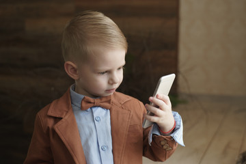 Little boy talking on the phone with copy space