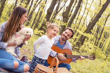 Parents enjoying picnic day with kid