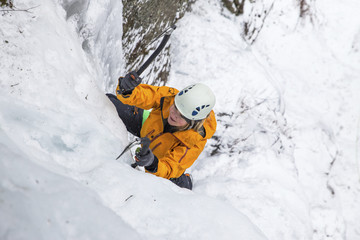 High angle view of woman ice climbing at White Mountains during winter