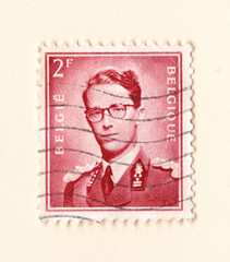 An old red belgium postage stamp with an image of king leopold