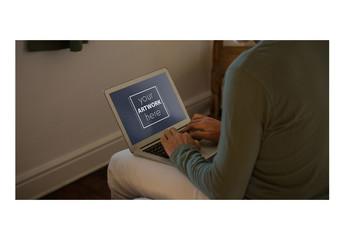 Laptop User in Bedroom Mockup