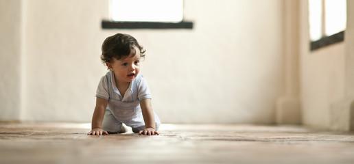 Toddler boy crawling.