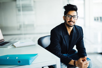 Indian Man Working At Computer In Contemporary Office