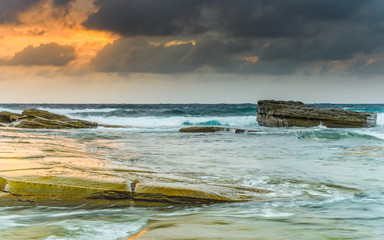 Rocky Sunrise Seascape with Clouds