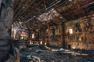 Ruined and abandoned dark creepy factory house building inside, industrial warehouse hall