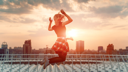 The girl is in flight. Girl jumping against city background, concept.