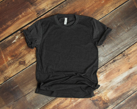 Mockup of blank gray tshirt on rustic wood background