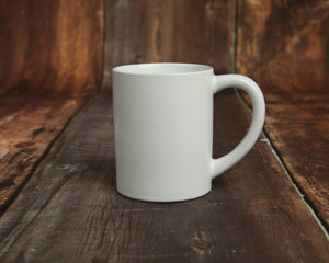 Blank white mug mockup photo on rustic wood
