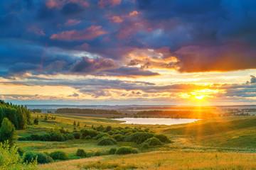 Rural summer landscape at sunset